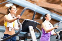 Women on treadmill Royalty Free Stock Photography