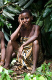 Women from a tribe of pygmies sit in the forest. Stock Photo