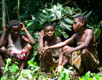 Women from a tribe of pygmies sit in the forest. Royalty Free Stock Photography