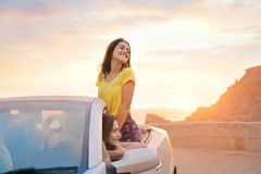 Women on trip. With cabrio Royalty Free Stock Images
