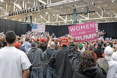 A `Women for Trump` sign is held up during the Trump MAGA Rally at the International Exposition Center in Cleveland, Ohio, USA stock image