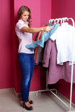 Women trying on clothes Stock Photos