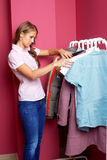 Women trying on clothes at shopping mall Royalty Free Stock Photography