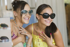 Women Trying On Sunglasses In Store Stock Image