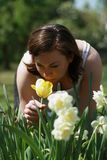 Women and  a tulip. Pregnant woman sniffing the tulip in the garden Royalty Free Stock Photos