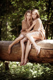 Women, twins in the forest royalty free stock image