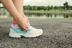 Women tying sport shoe prepare jogging at park. Stock Image