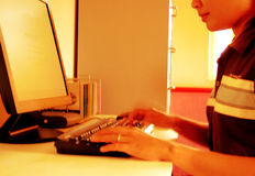 Women typing. From side view. Motion blurred stock photos