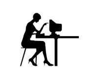 Women typing at a computer. Black silhouette the women typing at a computer Stock Photography