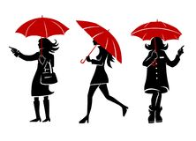 Women with ubrellas. Women walking in the street with umbrellas Stock Illustration