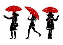 Women with ubrellas. Women walking in the street with umbrellas Stock Photo