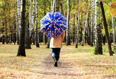 Women with umbrella Stock Photography