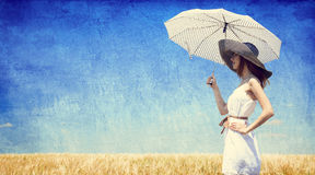 Women with umbrella at wheat field. Stock Photography