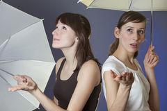 Women with umbrellas Stock Image