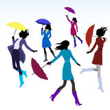 Women with umbrellas Stock Images