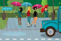 Women under umbrellas in the rainy autumn weather  Stock Images
