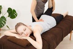 Women undergoing a massage stock photography