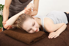 Women undergoing a massage royalty free stock images