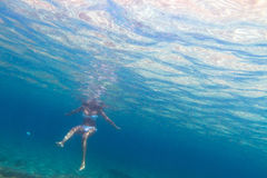 Women underwater in Aegean Sea. Of Greece Royalty Free Stock Photo