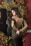Women unzip dress. Women unzip elegant evening dress Stock Photo