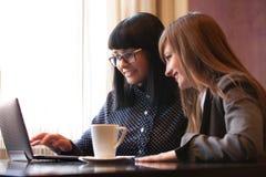 Women use netbook Stock Image
