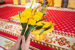 Women are using candles, flowers, incense, pray for priests. Women are using candles, flowers, incense, pray for priests in the temple stock images