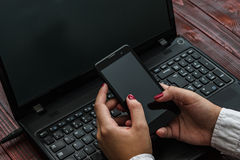 Women Using Cellphone. View from Above. Selective Focus Royalty Free Stock Image