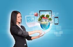 Women using digital tablet and Earth with Royalty Free Stock Images