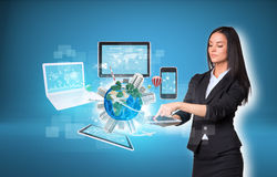 Women using digital tablet and Earth with Stock Photo