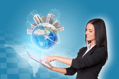 Women using digital tablet. Earth with buildings Stock Images