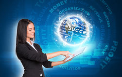 Women using digital tablet. Earth with business Stock Photo