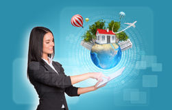 Women using digital tablet. Earth with house and Stock Image