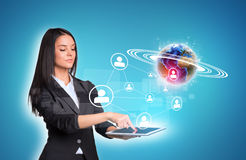 Women using digital tablet and Earth with network Royalty Free Stock Photography