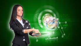 Women using digital tablet and Earth with network Royalty Free Stock Photo