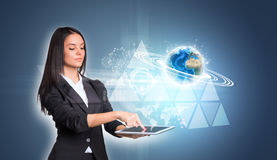 Women using digital tablet and Earth triangles Stock Photo