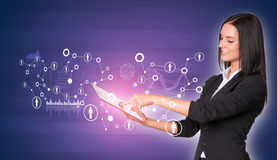 Women using digital tablet and network with people. Beautiful businesswomen in suit using digital tablet. Network with people icons and graphs stock image