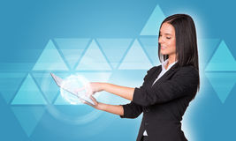 Women using digital tablet. Transparent triangles Stock Photography
