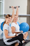 Women using dumbbells in fitness Stock Photo