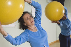 Women Using Exercise Balls Stock Photo