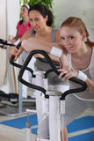Women using exercise equipment Royalty Free Stock Photo