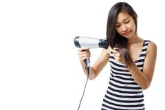 Women using hair dryer. Women are using a hair dryer Royalty Free Stock Images