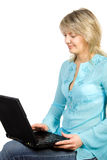 Women using laptop. Pretty women using laptop. Isolate on white Royalty Free Stock Photography
