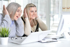 Women using laptop and computer Royalty Free Stock Image