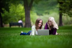 Women Using Laptop in Park Stock Images