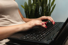 Women Using Laptop. Working From Comfort of Your Home. Side View. Selective Focus Stock Image