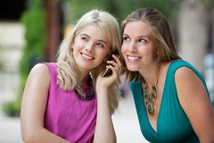 Women Using A Mobile Phone Royalty Free Stock Photo