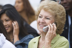 Women Using Mobile Phones Royalty Free Stock Photos