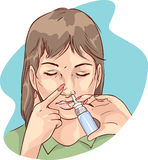 A women using nasal spray medication Stock Photos