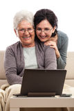 Women using notebook at home Stock Image