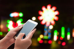 The women using smart phone on blurred light street Royalty Free Stock Photography